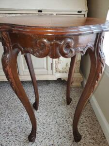Antique side table with wonderful wood carving.