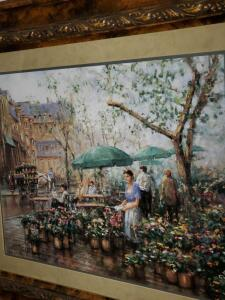Print of street scene with flowers vendors.