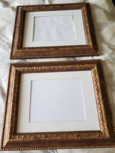 Two matching antique gold color frames with mat cut to 8 x 10