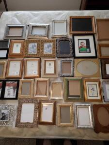 Large grouping of 8x10 and smaller frames.
