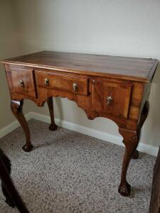 Antique chippendale style ladies desk with ball and claw feet.