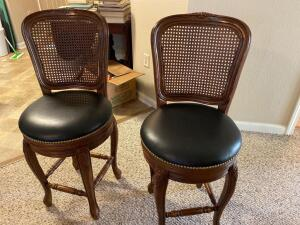 Pair of swivel barstools with Cain backing