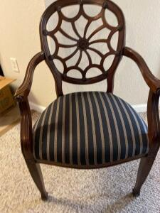 Armed occasional chair with a fabulous decorative back