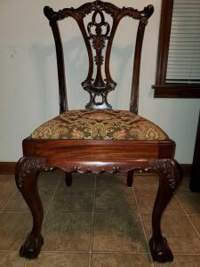 Antique dining chairs with claw and ball front legs.