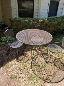Metal patio table and 3 ice-cream-shop style chairs.