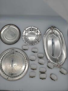Silver plate grouping of trays and 12 napkin rings.