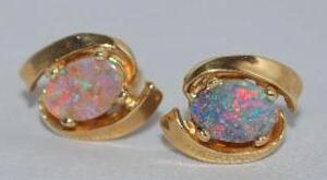 Pair of 14 K Gold and Opal earrings