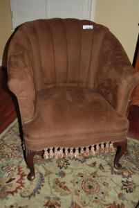 Antique chocolate, suede occasional chair with tassel accents