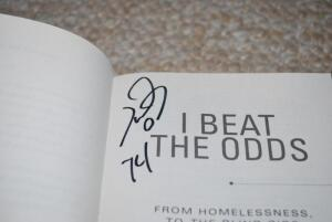 "Signed Copy of Michael Oher's book, ""I Beat the Odds"""