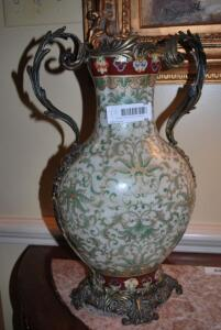 Porcelain and metal decorative Urn - green,gold, and oxblood in color