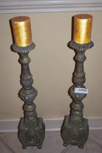 Grand wooden candlestick holders with candles
