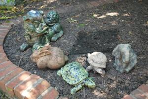 Variety of stone, resin, ceramic, and painted yard art