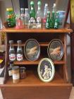 Small wood hutch filled with vintage collectibles
