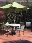 Outdoor table and 5 chairs with umbrella