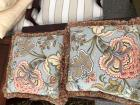 Pair of decorative pillows in colors of blue green and red