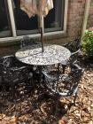 Heavy outdoor wrought iron table and chairs with umbrella