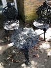 Child size wrought iron table and small chairs