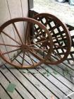 Pair of decorative wagon wheels and cowboy cutout
