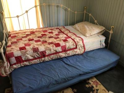 Brass and white trundle bed