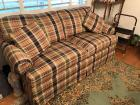 Plaid a poster and love seat