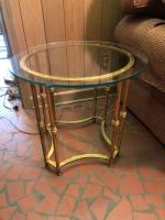 Glass top end table with gold colored base