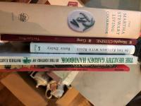 Box of various books including cookbooks, gardening books, self help books