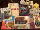 Grouping of books and a few supplies for crocheting and knitting