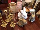Assortment of decorative items: bunnies, candle holders, vases, plates