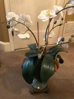 Arrangement of white silk orchids in celadon porcelain urn with bronze base and bronze side handles
