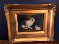 Small framed oil painting of bunnies