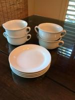 Four soup bowls with plates