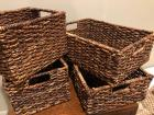 Two sets of storage baskets