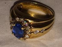 18 karat 9.7 Grams diamond and sapphire ring purchase price $3450.00