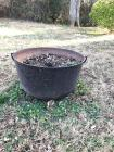 Large iron pot with handles.